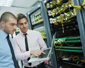 EPoS Software - group of young business people it engineer in network server room solving problems and give help and support